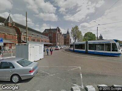 Ambulance naar Stationsplein in Amsterdam