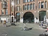 Ambulance naar Raadhuisstraat in Amsterdam