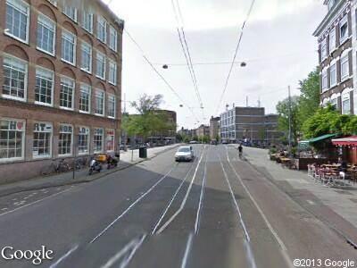 Ambulance naar Oosterdokskade in Amsterdam