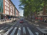 Ambulance naar Jodenbreestraat in Amsterdam