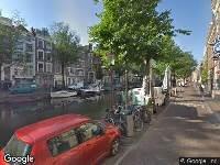 Ambulance naar Oudezijds Voorburgwal in Amsterdam