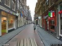 Ambulance naar Warmoesstraat in Amsterdam