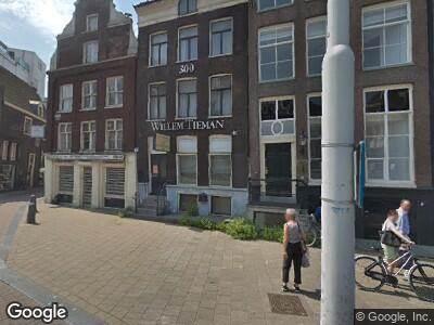 Ambulance naar Nieuwezijds Voorburgwal in Amsterdam