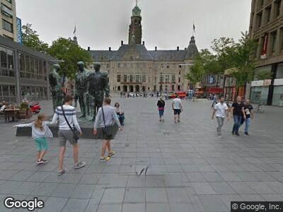 Ambulance naar Stadhuisplein in Rotterdam