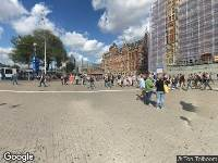 Ambulance naar Stationsplein in Amsterdam