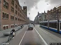 112 melding Ambulance naar Damrak in Amsterdam