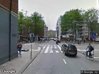 Ambulance naar Uilenburgersteeg in Amsterdam