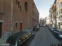 Ambulance naar Beursstraat in Amsterdam