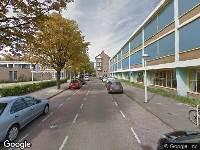 Ambulance naar Robert Scottstraat in Amsterdam