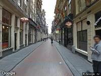 112 melding Ambulance naar Warmoesstraat in Amsterdam