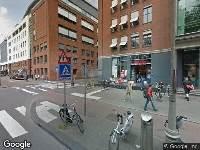 Politie naar Jodenbreestraat in Amsterdam vanwege huisvredebreuk