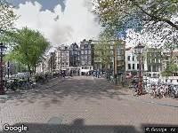 112 melding Politie naar Prinsengracht in Amsterdam vanwege personen te water