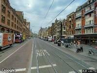Ambulance naar Damrak in Amsterdam