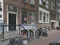 112 melding Ambulance naar Oudezijds Voorburgwal in Amsterdam