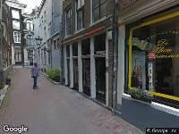 112 melding Politie naar Enge Kerksteeg in Amsterdam vanwege vechtpartij