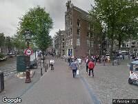 112 melding Besteld ambulance vervoer naar Oudezijds Voorburgwal in Amsterdam