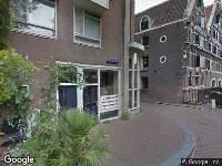 Ambulance naar Nieuwe Amstelstraat in Amsterdam