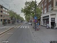 Ambulance naar West-Kruiskade in Rotterdam