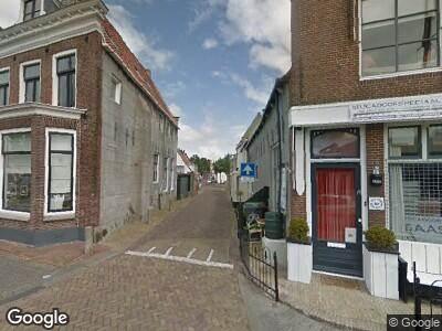 Ambulance en brandweer naar Zuiderhaven in Harlingen vanwege een scheepsbrand