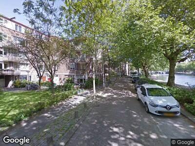 Ambulance met gepaste spoed naar Rechter Rottekade in Rotterdam