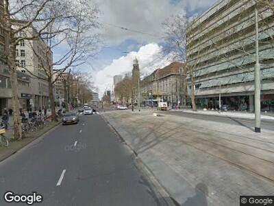 Ambulance met gepaste spoed naar Coolsingel in Rotterdam