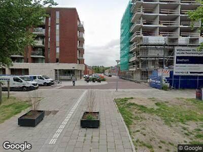 Ambulance met grote spoed naar Limmenstraat in Amsterdam