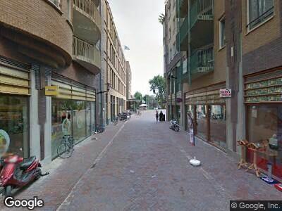 Ambulance met grote spoed naar Oranje-Vrijstaatplein in Amsterdam