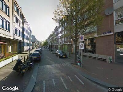 Ambulance met grote spoed naar Tweede van Swindenstraat in Amsterdam