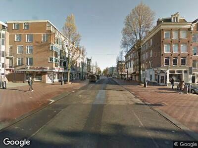 Ambulance met gepaste spoed naar Wagenaarstraat in Amsterdam