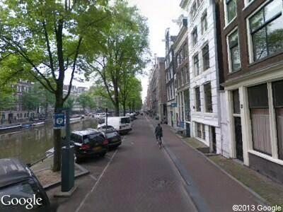 Ambulance met gepaste spoed naar Singel in Amsterdam