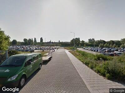 Ambulance met gepaste spoed naar Kleiweg in Rotterdam