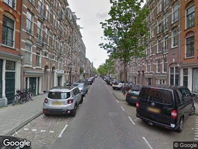 Ambulance met grote spoed naar Derde Oosterparkstraat in Amsterdam