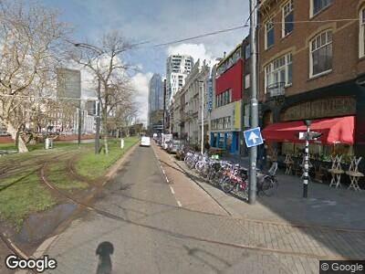 Ambulance met gepaste spoed naar Mauritsweg in Rotterdam