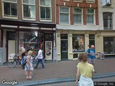 Ambulance met gepaste spoed naar Nieuwe Hoogstraat in Amsterdam