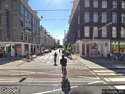 Ambulance met grote spoed naar Van Baerlestraat in Amsterdam