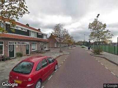 Ambulance met gepaste spoed naar Van Oosten de Bruijnstraat in Haarlem