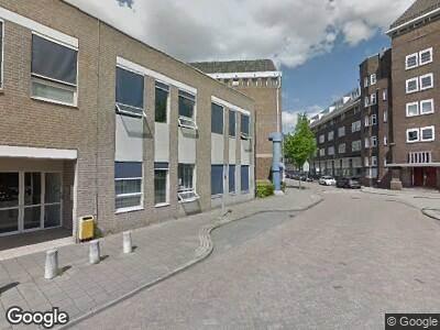 Ambulance met gepaste spoed naar Deken van Somerenstraat in Eindhoven vanwege brand