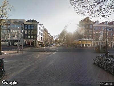 Ambulance met grote spoed naar Pieter Vlamingstraat in Amsterdam