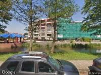 112 melding Ambulance naar Ravensteinstraat in Amsterdam