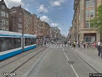 Ambulance naar Dam in Amsterdam