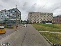 Ambulance naar John M. Keynesplein in Amsterdam