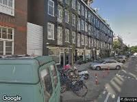 Ambulance naar De Wittenstraat in Amsterdam