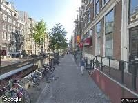 Ambulance naar Oudezijds Achterburgwal in Amsterdam