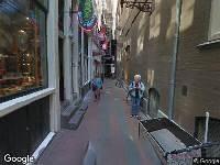 Ambulance naar Jonge Roelensteeg in Amsterdam