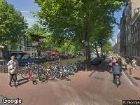 Ambulance naar Kloveniersburgwal in Amsterdam
