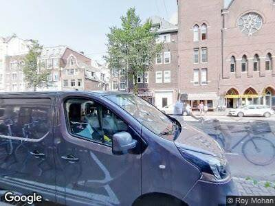 Ambulance naar Rozengracht in Amsterdam