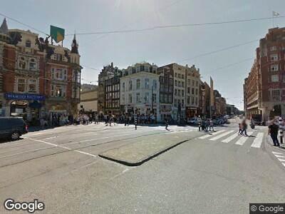 Ambulance naar Muntplein in Amsterdam