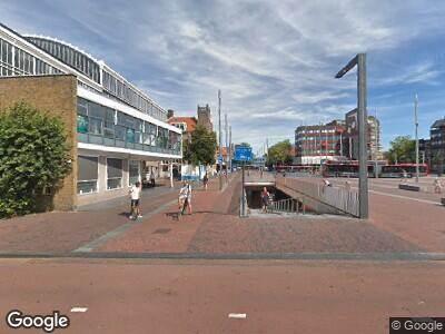 Ambulance naar Stationsplein in Haarlem