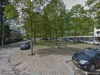 Ambulance naar Van der Helmstraat in Rotterdam