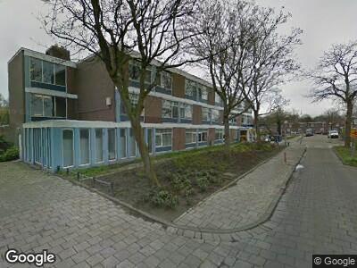 Ambulance met gepaste spoed naar Watermanstraat in Amsterdam